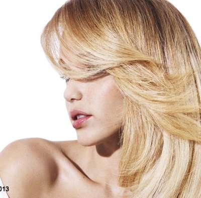 Entretenir les reflets du soleil sur cheveux colorés